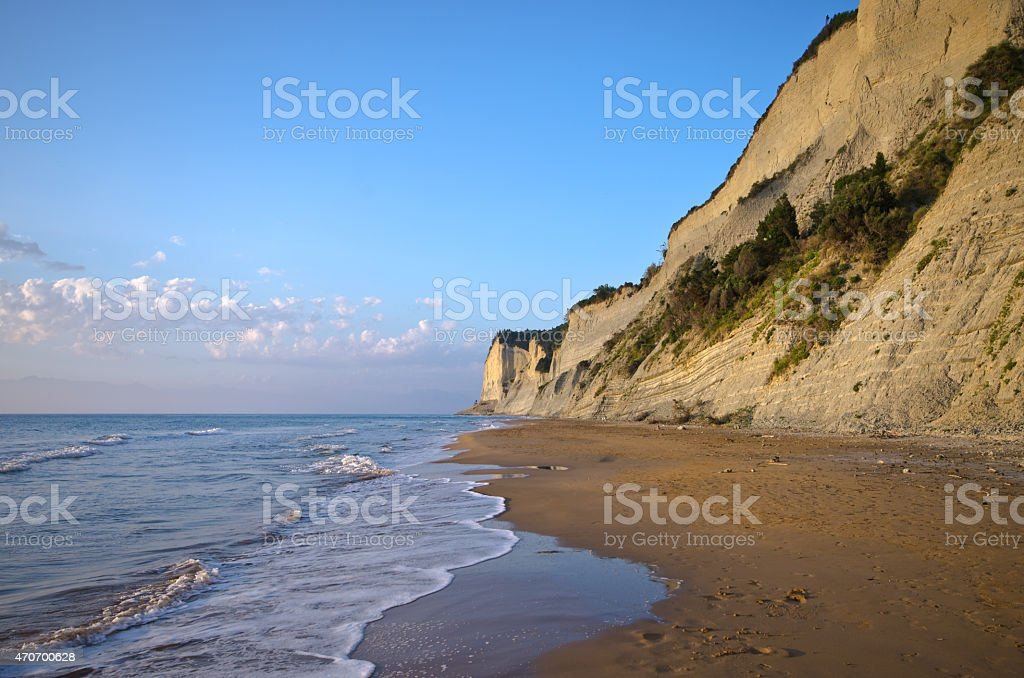 Beach and steep cliffs near Agios Stefanos, Corfu island, Greece stock photo