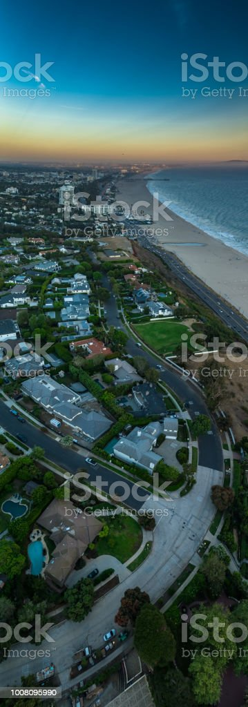 Beach and Streets in Pacific Palisades, California - Vertical Aerial Panorama stock photo