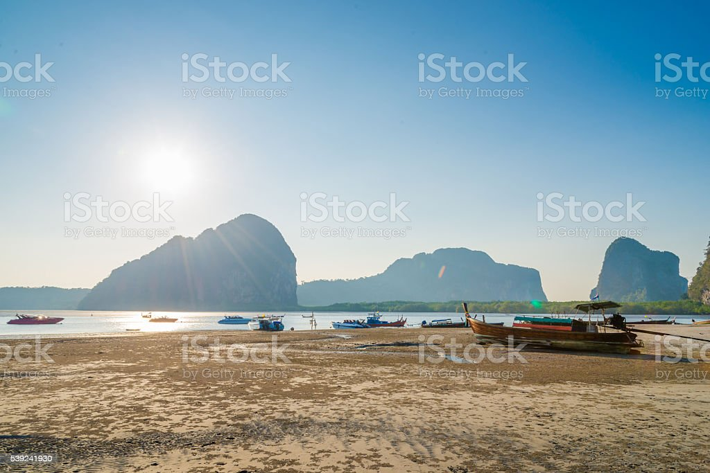 Beach and tropical sea with long-tail boat in thailand royalty-free stock photo