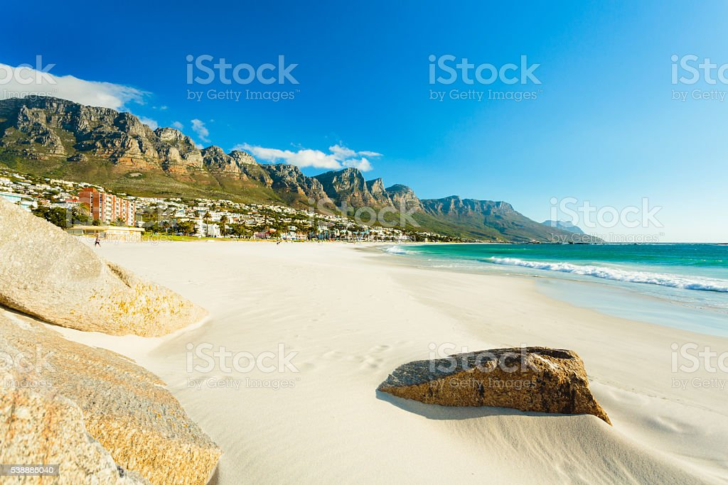 Beach and Twelve Apostles mountain in Camps Bay, Cape Town stock photo