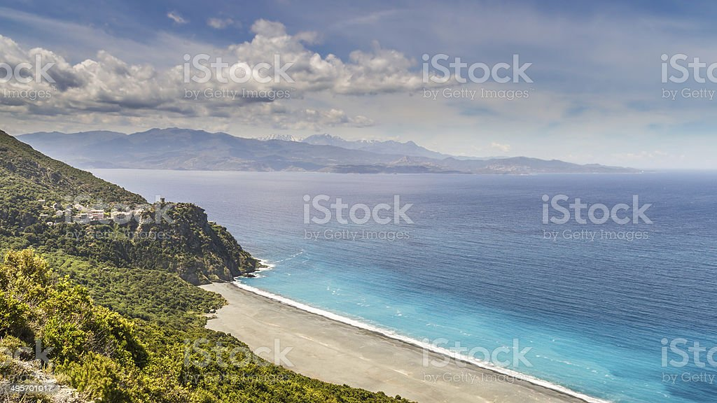 Beach and village of Nonza on Cap Corse in Corsica stock photo