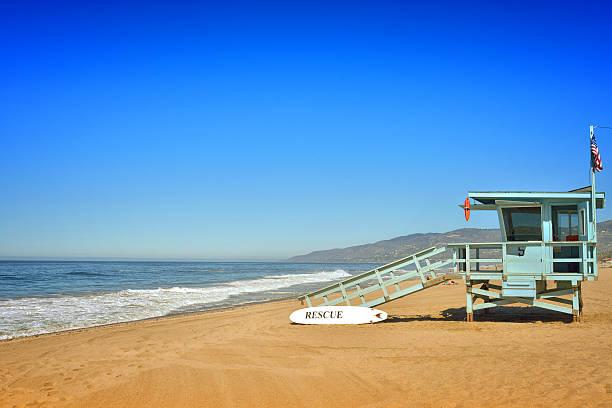 beach and watch tower in malibu - badvaktshytt bildbanksfoton och bilder