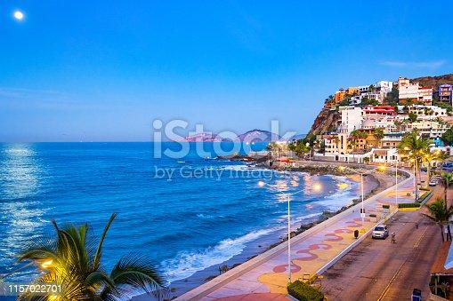 Stock photograph of beach and waterfront promenade in Mazatlan, Sinaloa, Mexico at twilight blue hour.