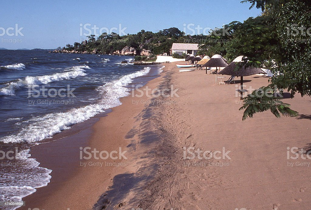 Beach and waves along Lakeshore Lake Malawi Malawi Africa stock photo