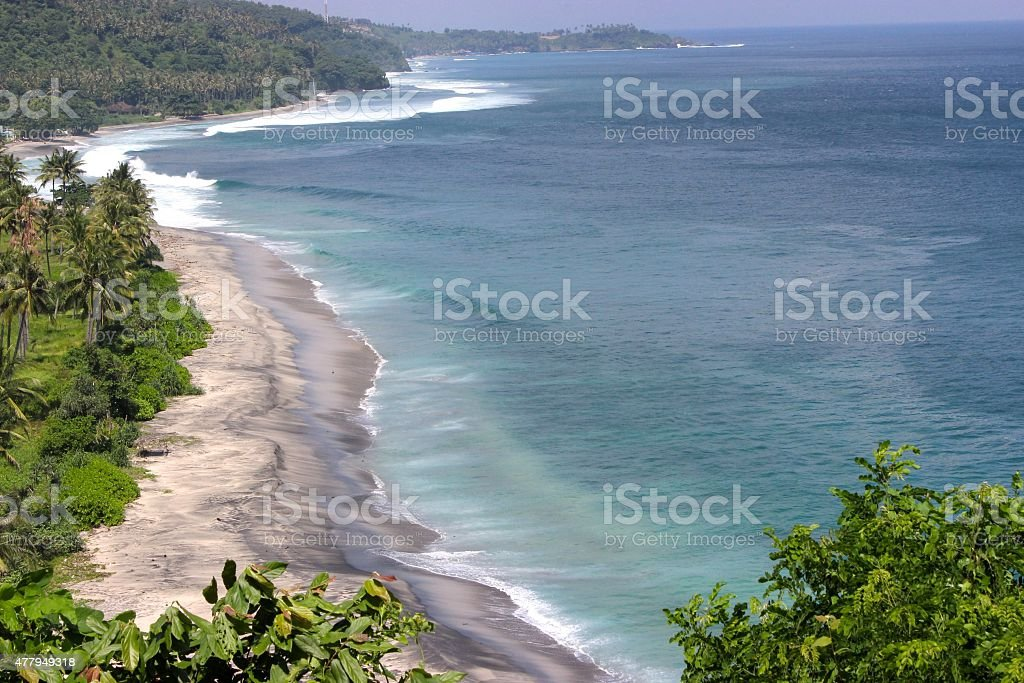 Beach and Waves from Cliff in Margit, near Sengiggi, Lombok stock photo