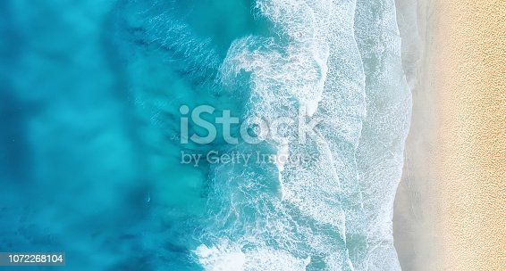 istock Beach and waves from top view. Turquoise water background from top view. Summer seascape from air. Top view from drone. Travel concept and idea 1072268104