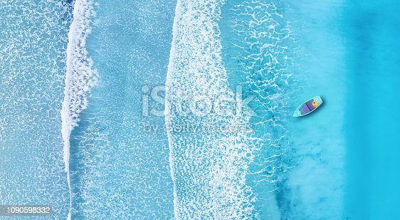1127346848 istock photo Beach and waves from top view. Turquoise water background from top view. Summer seascape from air. Top view from drone. Travel concept and idea 1090598332