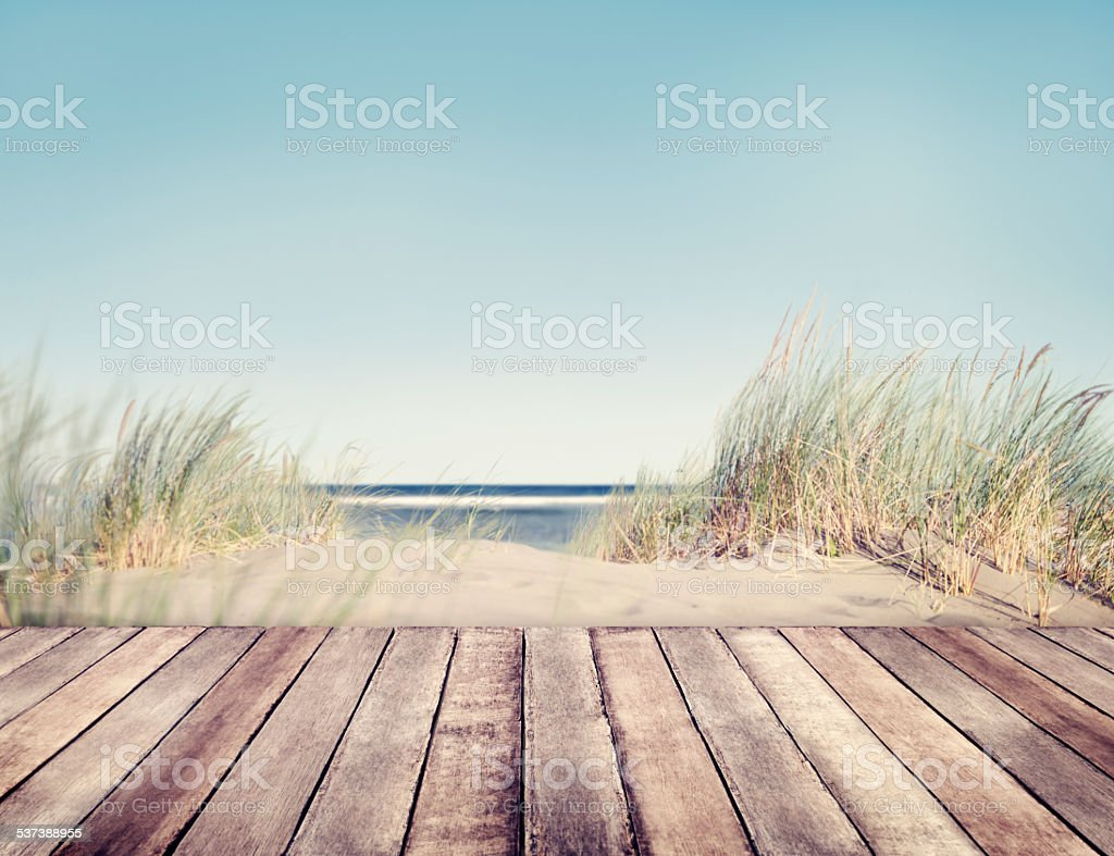 Beach and Wooden Plank stock photo