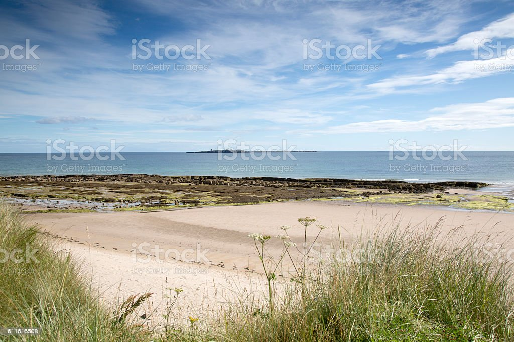 Beach at Bamburgh with Farne Islands, Northumberland stock photo