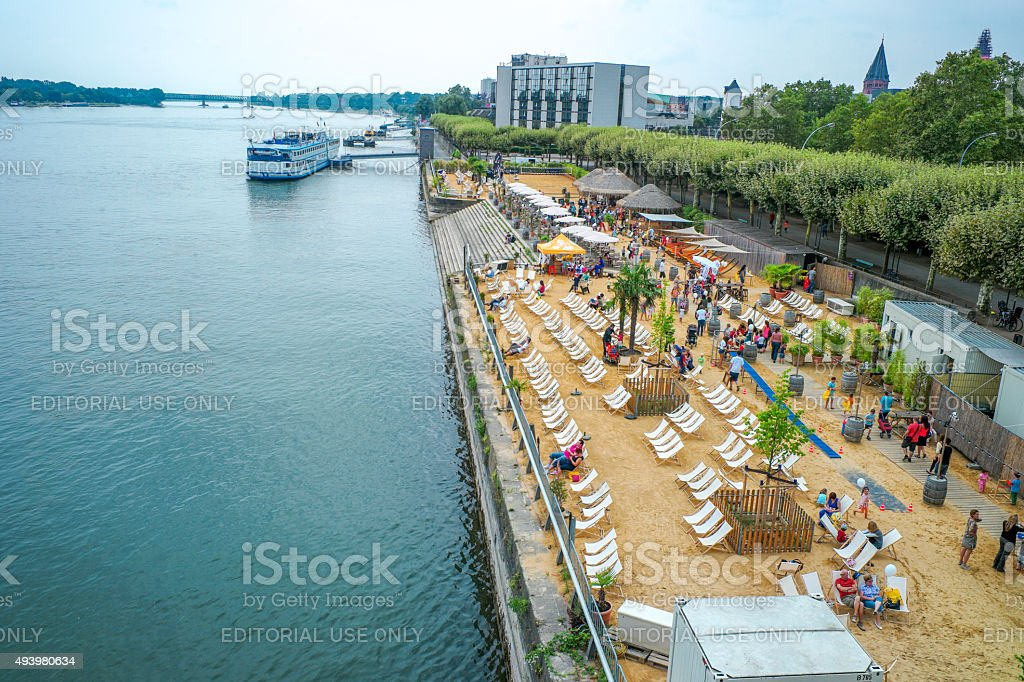 beach at coast of rhein river in mainz germany stock photo
