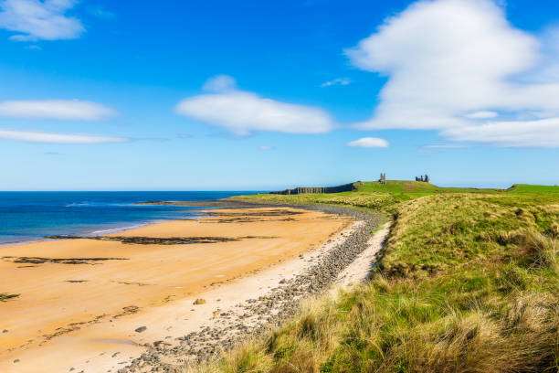 Beach at Dunstanburgh Castle in Northumberland stock photo