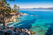Stock photograph of a beautiful beach at the eastern shores of Lake Tahoe at Sand Harbor, Nevada, USA on a sunny morning.