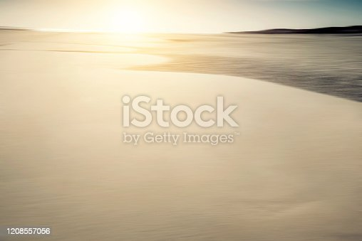 825992650 istock photo Beach background blurred motion, defocused sand 1208557056