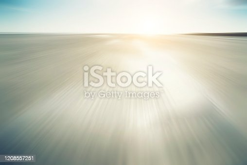 825992650 istock photo Beach background blurred motion, defocused sand 1208557251