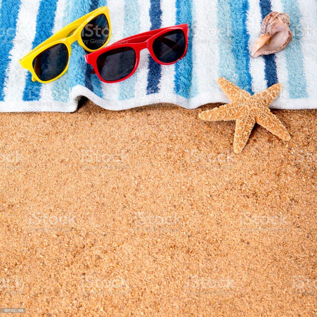 Beach background border sunglasses, towel, starfish seashell square format stock photo