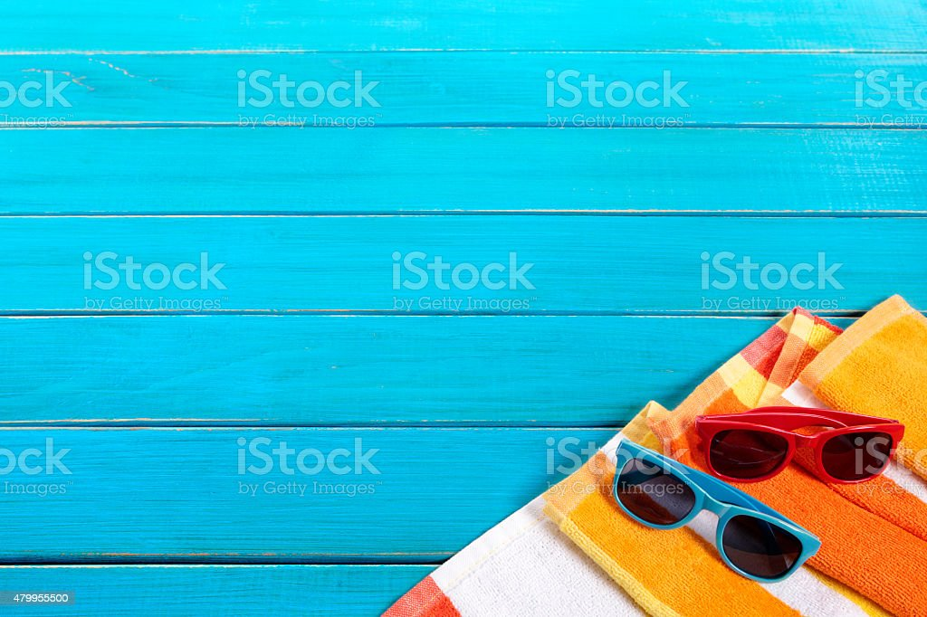 Beach background border with blue wood decking stock photo