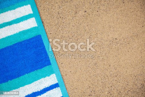 Beach towel on sand with copy space.