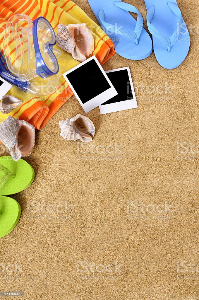 Beach background with towel, flip flops and blank photo prints. Paths...
