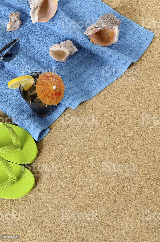 Beach background with iced cola and flip flops royalty-free stock photo