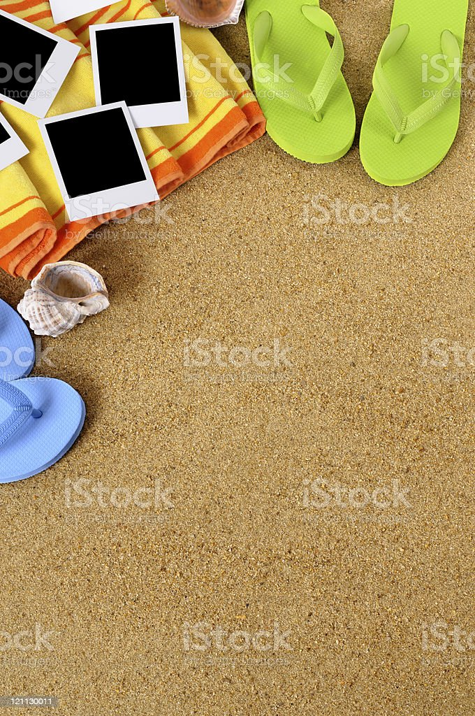 Beach background with towel, flip flops and blank photo prints ....