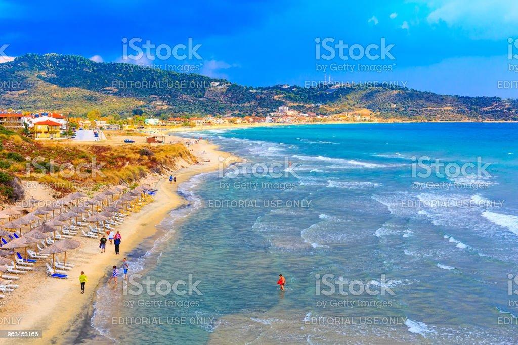 beach background with turquoise sea water waves and umbrellas, Greece - Zbiór zdjęć royalty-free (Bez ludzi)