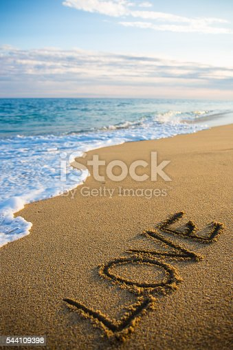 istock beach background with word love written in sand 544109398