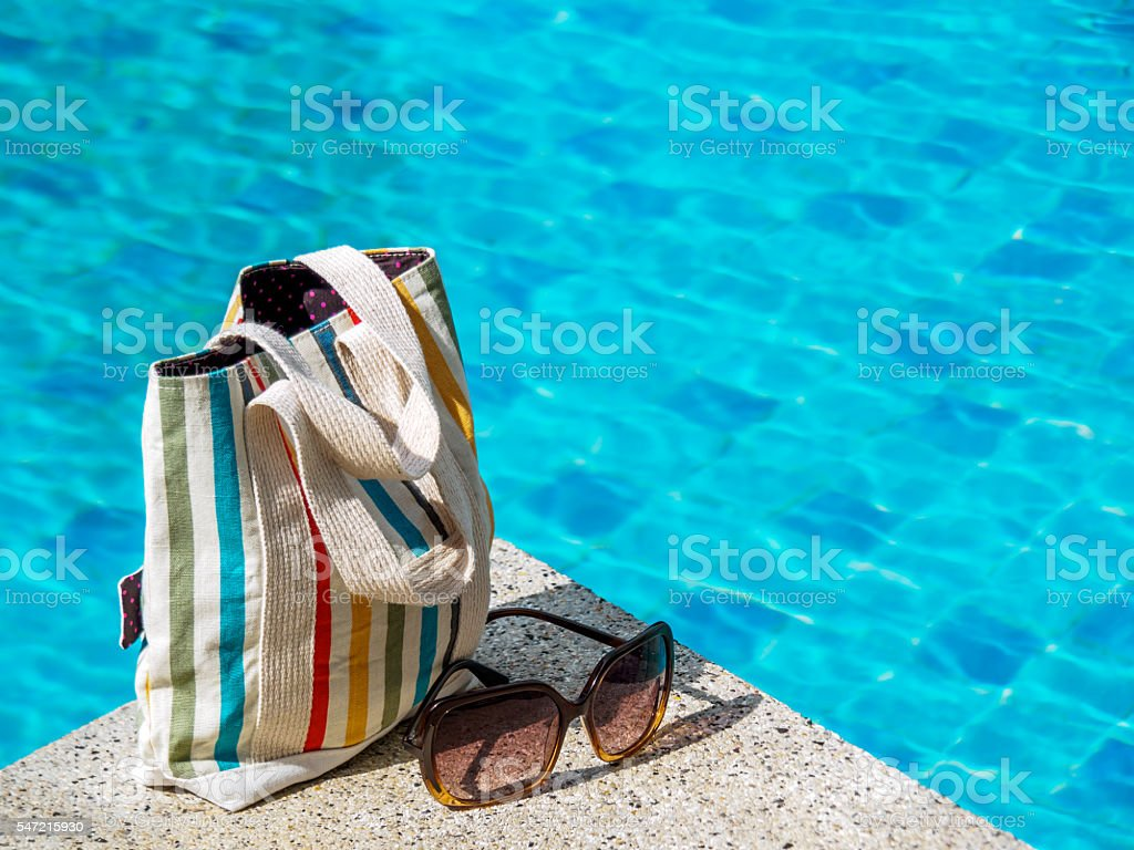 Beach Bag Sun Glasses Over Swimming Pool Background ...