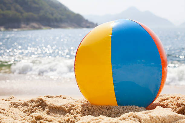 beach ball by the ocean - beach ball stock photos and pictures
