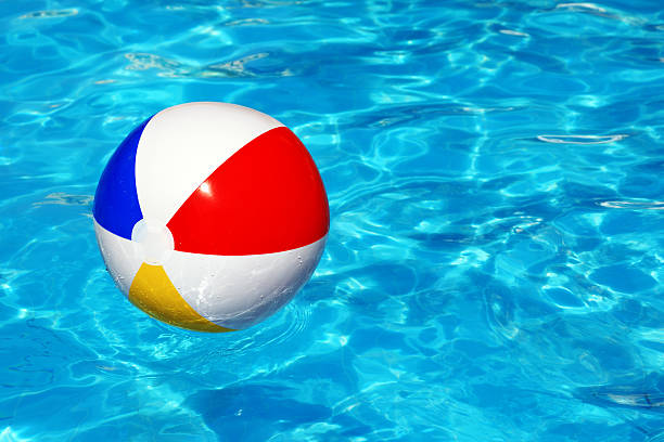 beach ball in swimming pool - beach ball stock photos and pictures
