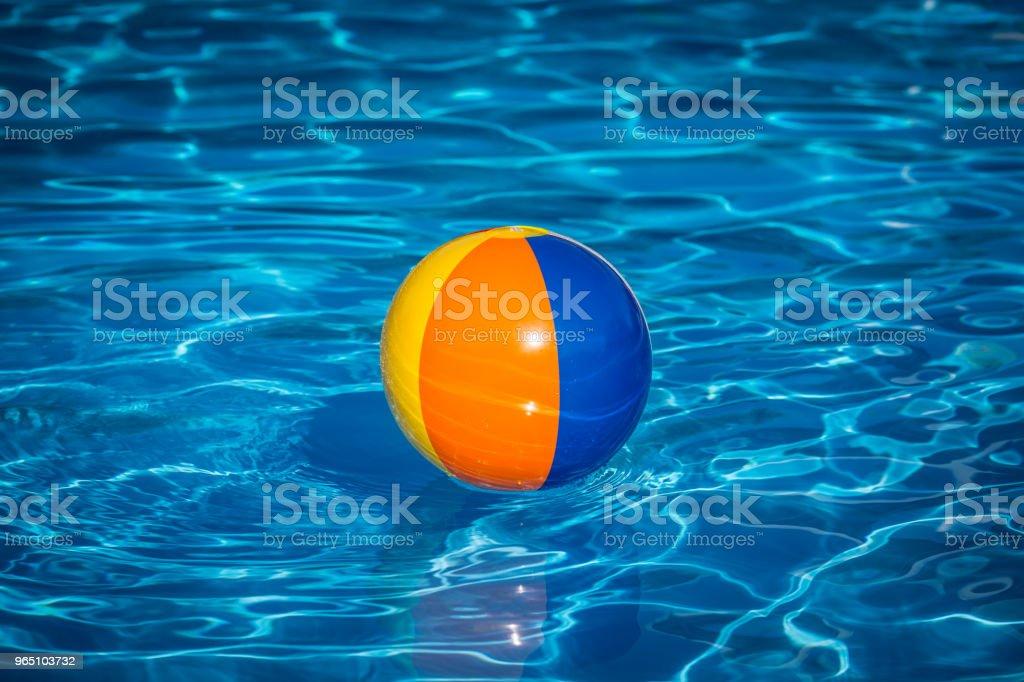 Beach ball in swimming pool royalty-free stock photo