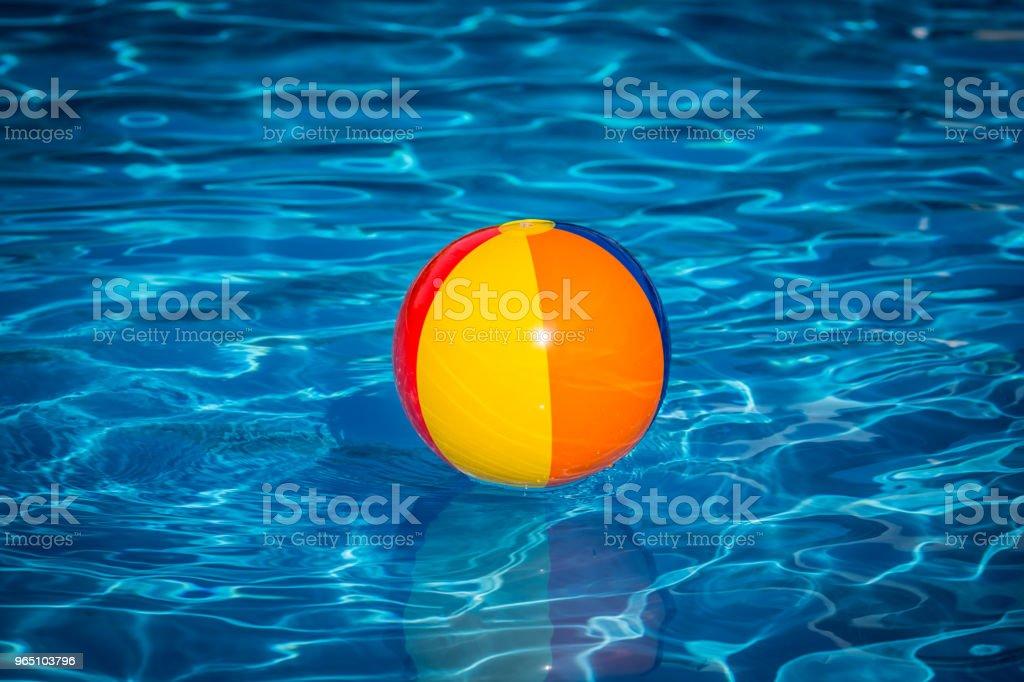 Beach ball in swimming pool zbiór zdjęć royalty-free