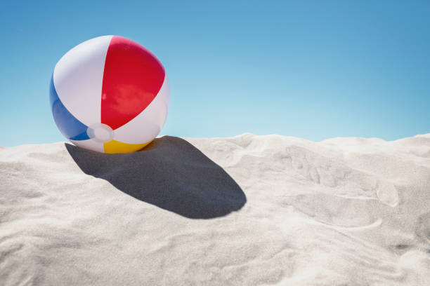 Beach ball on the sand stock photo