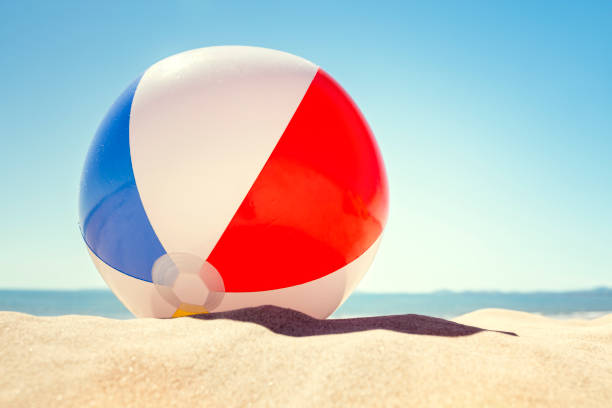 beach ball on the sand - beach ball stock photos and pictures