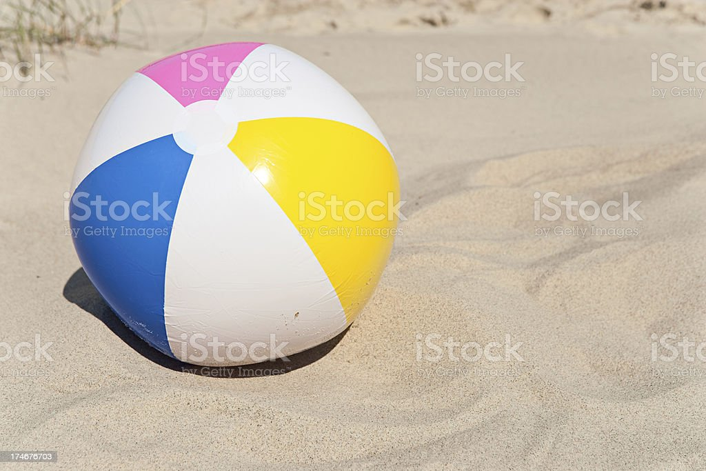beach ball in sand. simple beach beach ball in sand dune pictures images and stock photos for