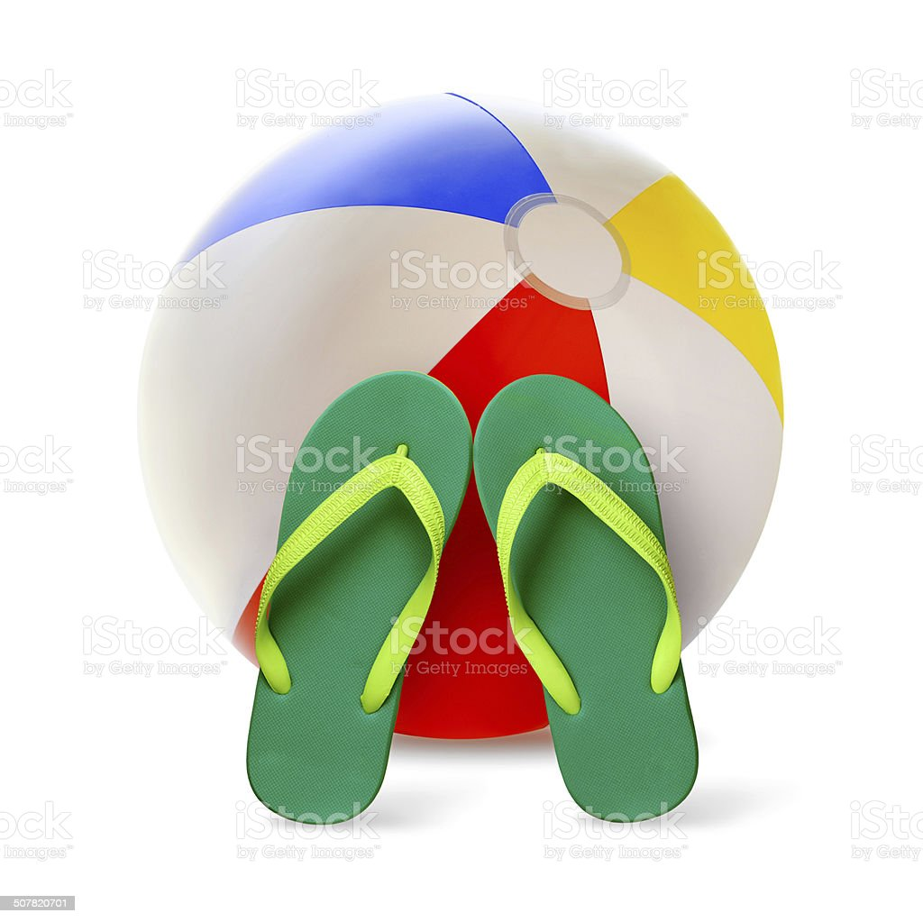 Beach ball with flip flops stock photo