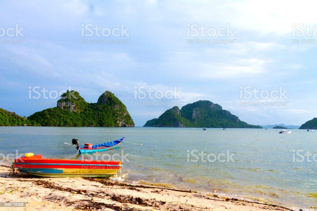 Beach Bang Boet and red small boat at Chumphon Province stock photo