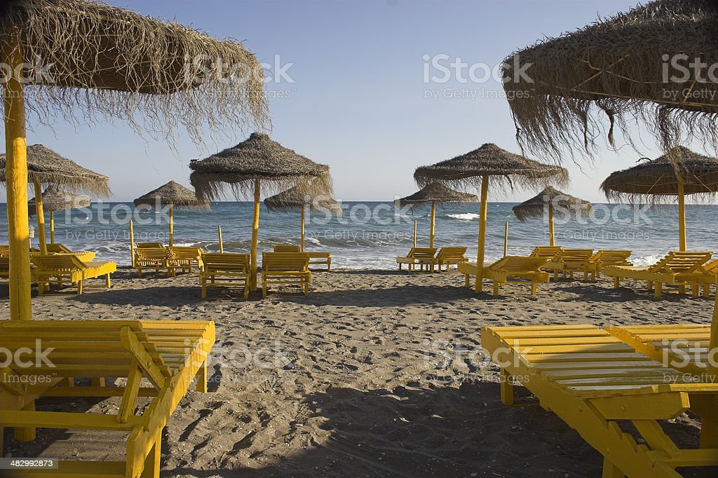 Beach beds and shades royalty-free stock photo