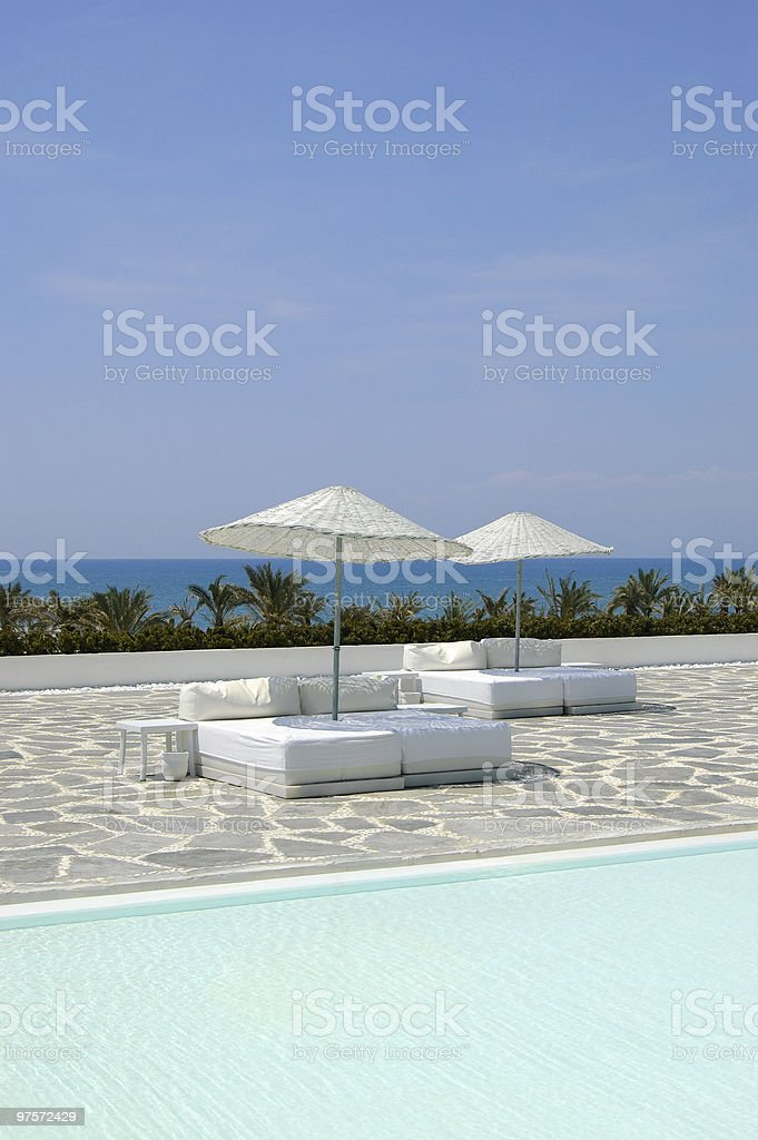 Beach beds near swimming pool, Antalya, Turkey royalty-free stock photo