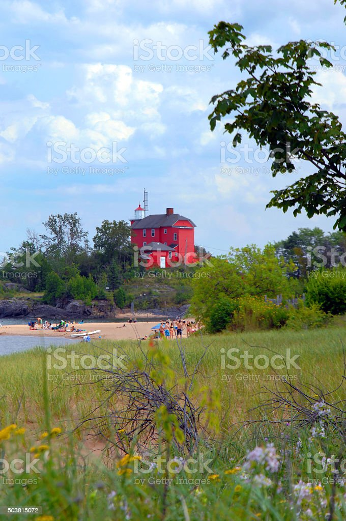 Beach Beneath Marquette Harbor Lighthouse stock photo