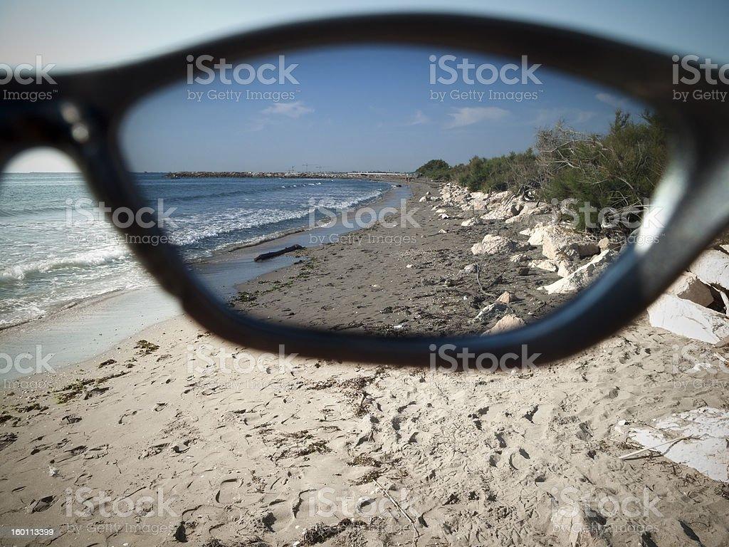 Beach beyond sunglasses stock photo