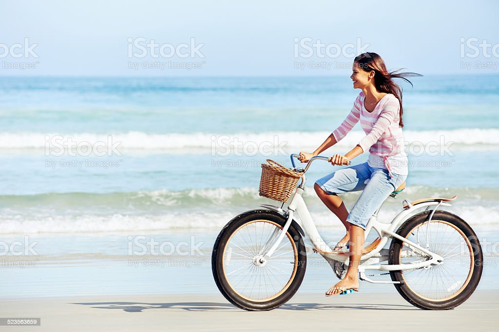 beach bicycle woman stock photo
