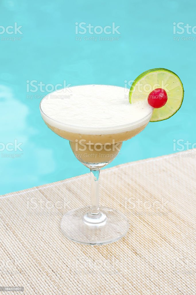Beach Blonde cocktail near waterpool on the mat stock photo