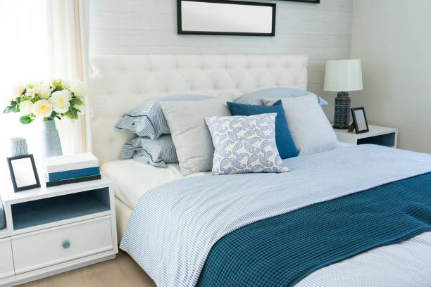 beach blue pillow on bed in bedroom stock photo