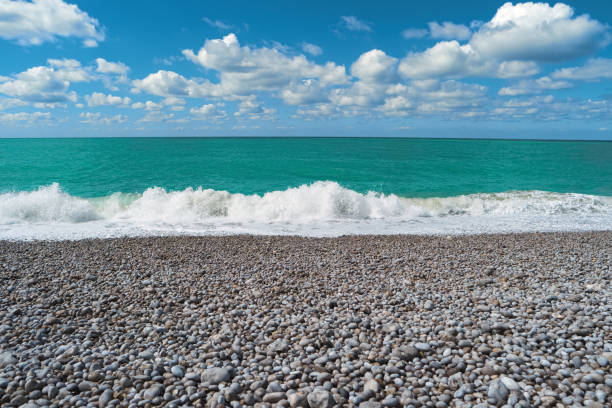 Beach, blue sea, cloudy sky. Beautiful landscape stock photo