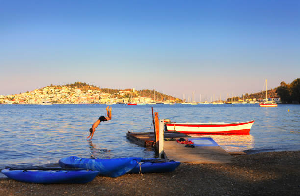 Beach boy joy with view on Poros island, Greece – zdjęcie
