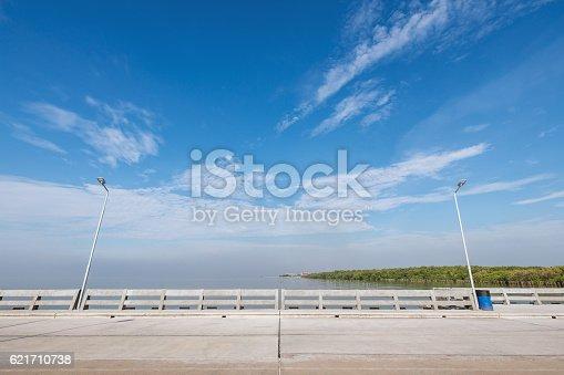 istock Beach bridge with cloudy blue sky 621710738