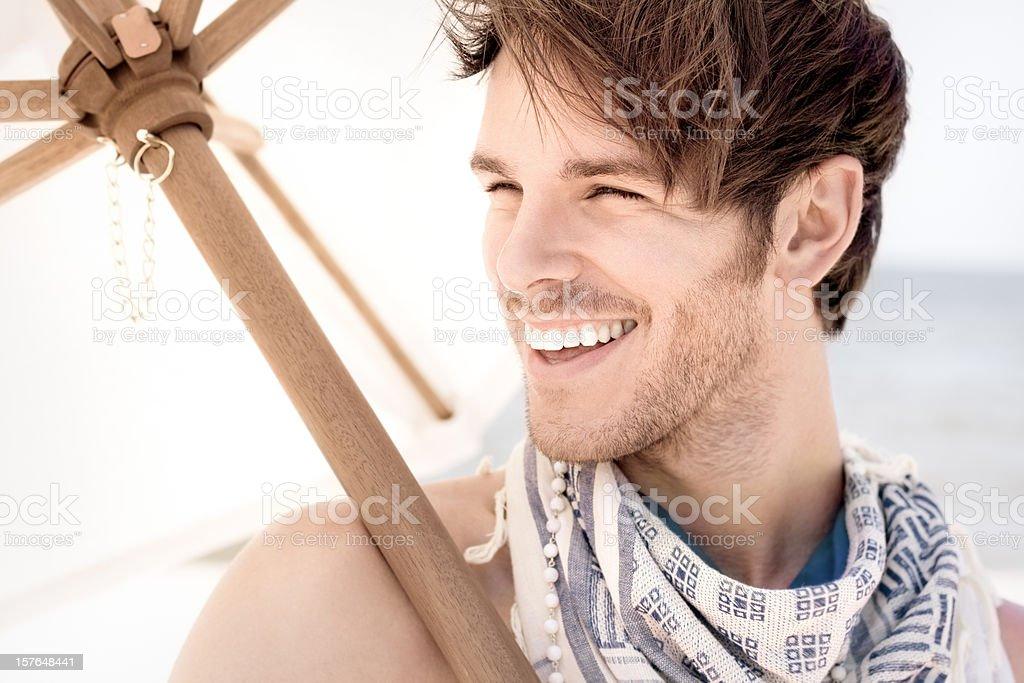 Beach Bum Guy With Umbrella royalty-free stock photo