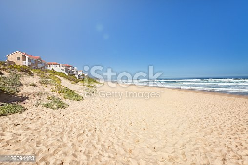 Public beach. Loneliness ans solitude on a wide sand beach perfect for summer holidays in South Africa. Perfect starting point for whale tours.