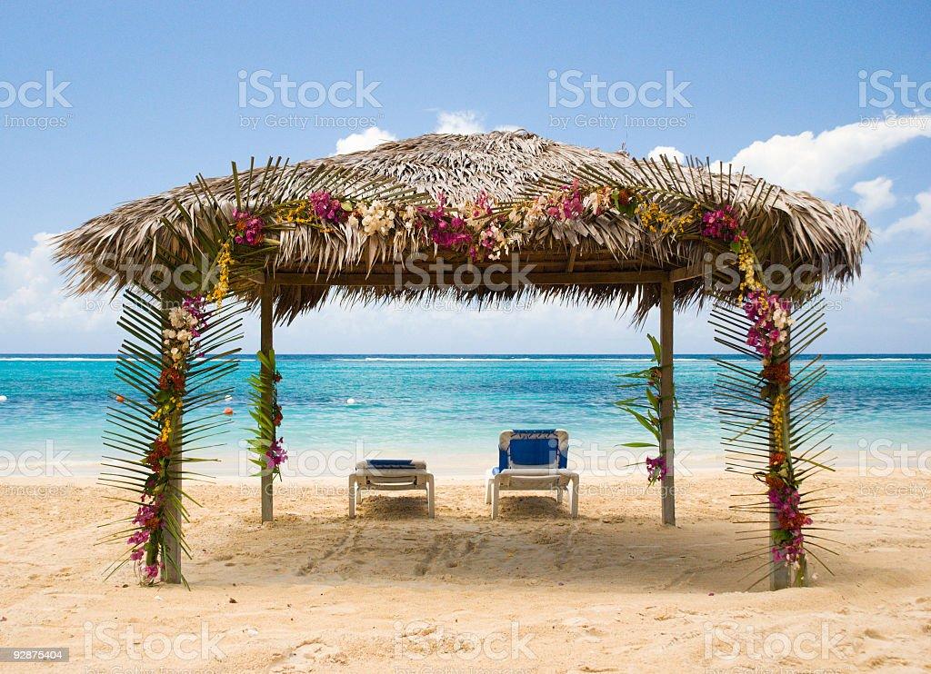 Beach cabana for two facing the Caribbean Sea royalty-free stock photo