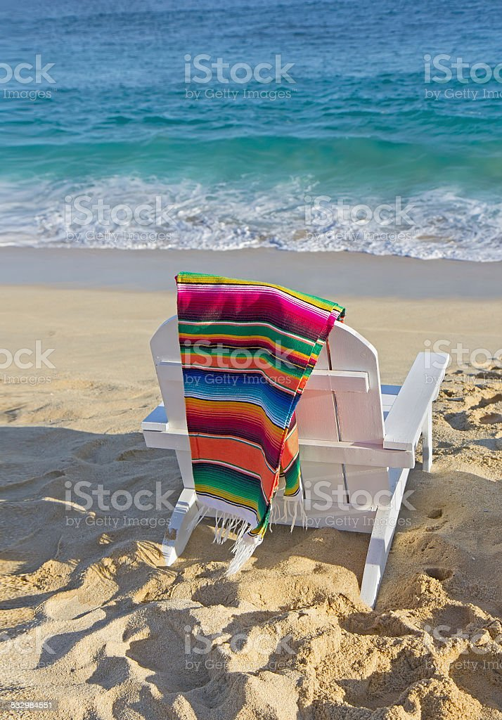 Beach chair near ocean stock photo
